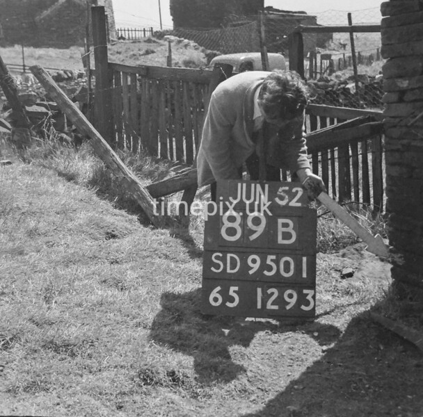 SD950189B, Man marking Ordnance Survey minor control revision point with an arrow in 1950s