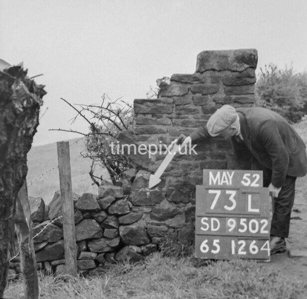 SD950273L, Man marking Ordnance Survey minor control revision point with an arrow in 1950s