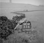SD960233B, Man marking Ordnance Survey minor control revision point with an arrow in 1950s
