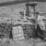 SD960127B, Man marking Ordnance Survey minor control revision point with an arrow in 1950s