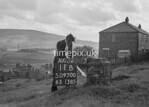 SD970011B, Man marking Ordnance Survey minor control revision point with an arrow in 1950s
