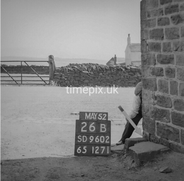 SD960226B, Man marking Ordnance Survey minor control revision point with an arrow in 1950s