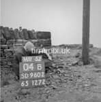 SD960204B, Man marking Ordnance Survey minor control revision point with an arrow in 1950s