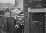 SD970011A, Man marking Ordnance Survey minor control revision point with an arrow in 1950s