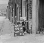 SD970146A, Man marking Ordnance Survey minor control revision point with an arrow in 1950s