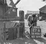 SD950127B2, Man marking Ordnance Survey minor control revision point with an arrow in 1950s