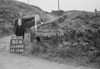 SD980282A, Man marking Ordnance Survey minor control revision point with an arrow in 1950s