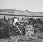 SD960209A, Man marking Ordnance Survey minor control revision point with an arrow in 1950s