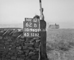 SD960162B, Man marking Ordnance Survey minor control revision point with an arrow in 1950s