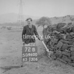 SD960072B, Man marking Ordnance Survey minor control revision point with an arrow in 1950s