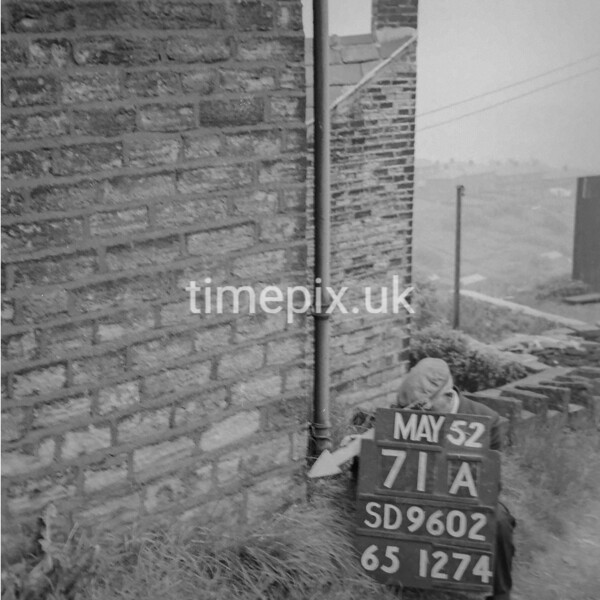 SD960271A, Man marking Ordnance Survey minor control revision point with an arrow in 1950s