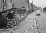 SD970225K, Man marking Ordnance Survey minor control revision point with an arrow in 1950s