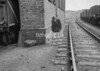 SD970061L, Man marking Ordnance Survey minor control revision point with an arrow in 1950s
