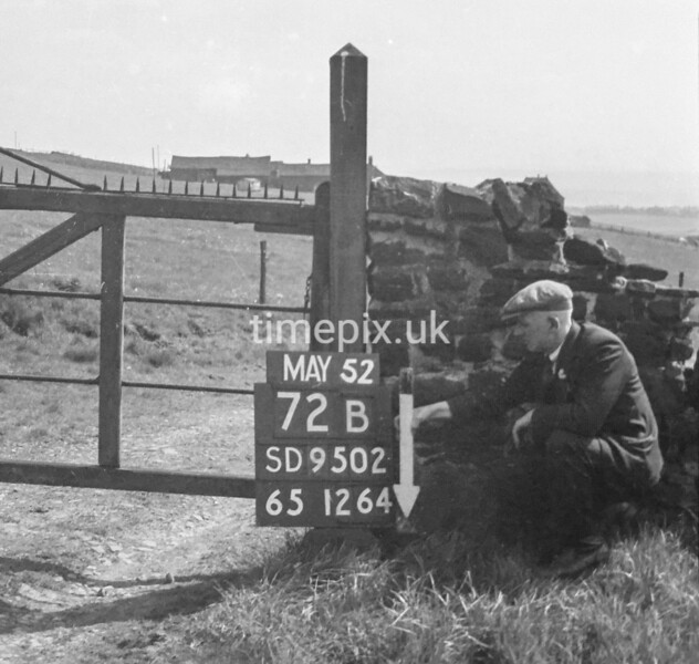 SD950272B, Man marking Ordnance Survey minor control revision point with an arrow in 1950s