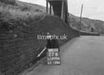 SD970027B, Man marking Ordnance Survey minor control revision point with an arrow in 1950s