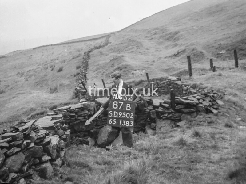 SD950287B, Man marking Ordnance Survey minor control revision point with an arrow in 1950s