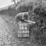 SD960074A, Man marking Ordnance Survey minor control revision point with an arrow in 1950s