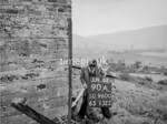 SD960090A, Man marking Ordnance Survey minor control revision point with an arrow in 1950s