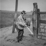 SD960138B, Man marking Ordnance Survey minor control revision point with an arrow in 1950s