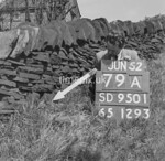 SD950179A, Man marking Ordnance Survey minor control revision point with an arrow in 1950s