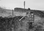 SD970133B, Man marking Ordnance Survey minor control revision point with an arrow in 1950s