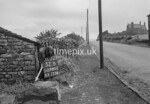 SD980232B, Man marking Ordnance Survey minor control revision point with an arrow in 1950s