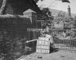 SD960297B, Man marking Ordnance Survey minor control revision point with an arrow in 1950s
