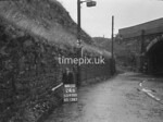 SD970024B, Man marking Ordnance Survey minor control revision point with an arrow in 1950s