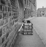 SD960292B, Man marking Ordnance Survey minor control revision point with an arrow in 1950s