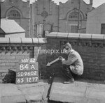 SD960284A, Man marking Ordnance Survey minor control revision point with an arrow in 1950s