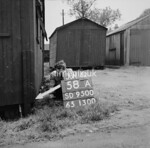 SD950058A, Man marking Ordnance Survey minor control revision point with an arrow in 1950s