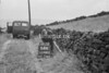 SD980264A, Man marking Ordnance Survey minor control revision point with an arrow in 1950s