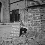 SD960276A, Man marking Ordnance Survey minor control revision point with an arrow in 1950s