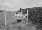 SD970049A, Man marking Ordnance Survey minor control revision point with an arrow in 1950s