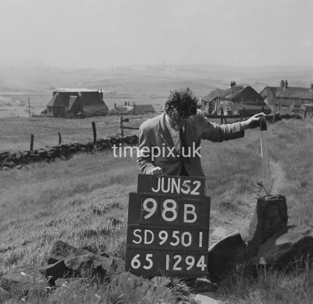 SD950198B, Man marking Ordnance Survey minor control revision point with an arrow in 1950s