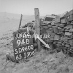 SD960094B, Man marking Ordnance Survey minor control revision point with an arrow in 1950s