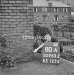 SD960280A, Man marking Ordnance Survey minor control revision point with an arrow in 1950s
