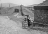 SD970274A, Man marking Ordnance Survey minor control revision point with an arrow in 1950s