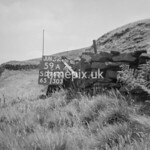 SD960059A, Man marking Ordnance Survey minor control revision point with an arrow in 1950s