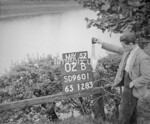 SD960102B, Man marking Ordnance Survey minor control revision point with an arrow in 1950s