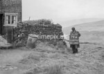 SD970279A, Man marking Ordnance Survey minor control revision point with an arrow in 1950s