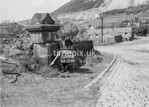 SD980098A1, Man marking Ordnance Survey minor control revision point with an arrow in 1950s