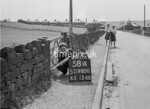 SD980058A, Man marking Ordnance Survey minor control revision point with an arrow in 1950s