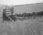 SD960034B, Man marking Ordnance Survey minor control revision point with an arrow in 1950s