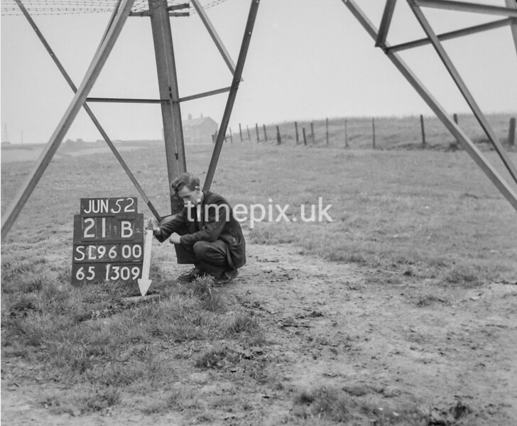 SD960021B, Man marking Ordnance Survey minor control revision point with an arrow in 1950s