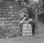 SD960281A, Man marking Ordnance Survey minor control revision point with an arrow in 1950s