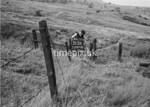 SD970015B, Man marking Ordnance Survey minor control revision point with an arrow in 1950s