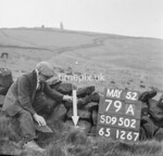 SD950279A, Man marking Ordnance Survey minor control revision point with an arrow in 1950s