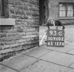 SD960293C, Man marking Ordnance Survey minor control revision point with an arrow in 1950s