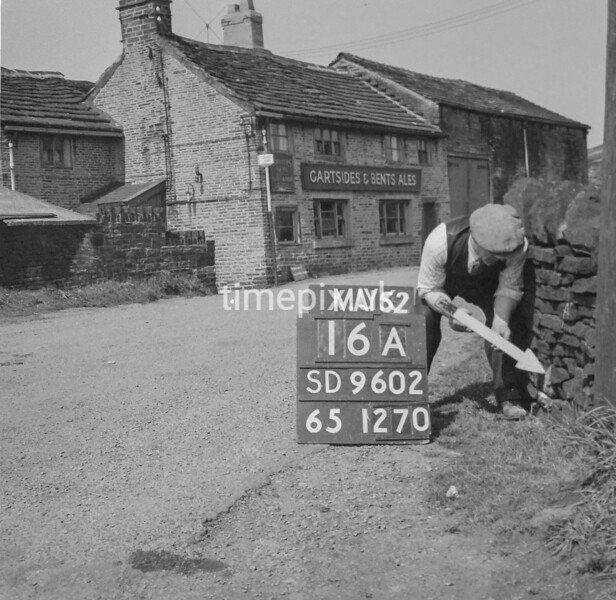 SD960216A, Man marking Ordnance Survey minor control revision point with an arrow in 1950s